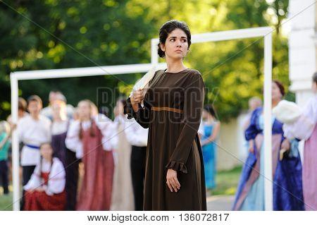 Orel Russia - June 24 2016: Turgenev Fest. Turgenev brunette girl in old fashioned dress with fan selective focus