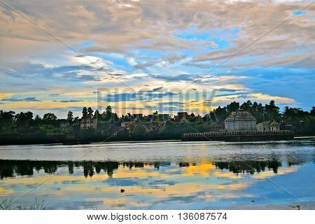 A beautiful reflection of sun and clouds on the lovely Bindusagar lake in Odisha