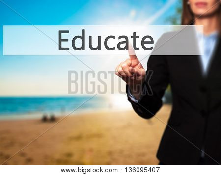 Educate - Businesswoman Hand Pressing Button On Touch Screen Interface.