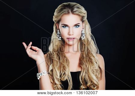 Gorgeous Woman with Makeup Blonde Curly Hairstyle and Jewelry on Black Background
