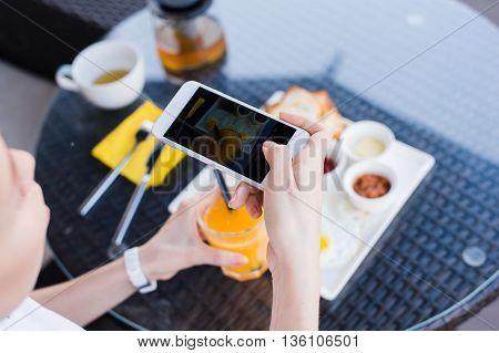 Woman hands taking food photo by mobile phone. Food photography. Delicious food