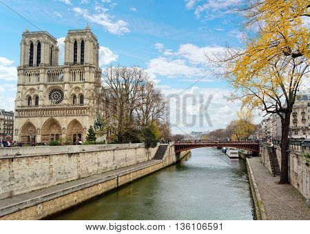 A view of beautiful gothic Notre Dame Cathedral on Il de la Cite and Seine river in Paris, France