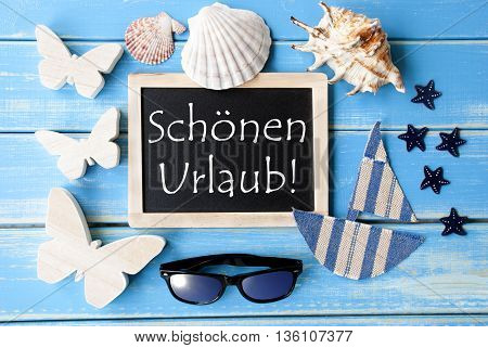 Flat Lay Of Chalkboard On Blue Wooden Background. Nautical Summer Decoration As Holiday Greeting Card. German Text Schoenen Urlaub Means Happy Holidays
