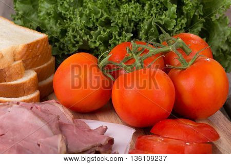 Fresh vine tomatoes with roast beef bread and lettuce
