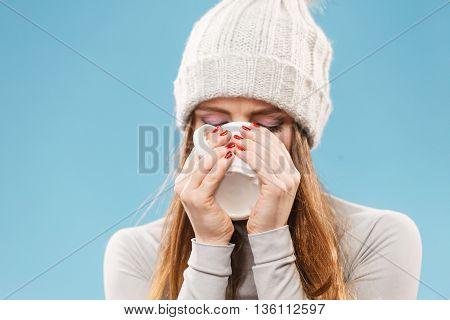 Woman In Winter Wool Cap Drinking Tea