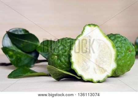 Bergamot (Other names are Kaffir lime Citrus Magnoliophyta Bergamot Rutaceae) fruits with leaf and half view