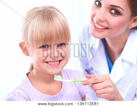 Dentist and little girl in the dentist office