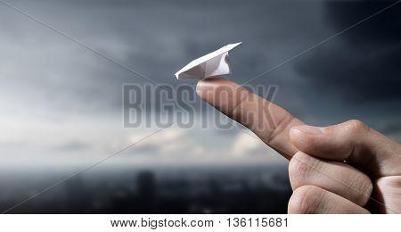 Paper plane on finger . Mixed media