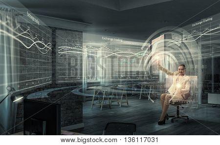 Businesswoman using media panel . Mixed media