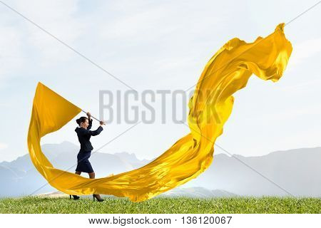 Woman waving yellow flag