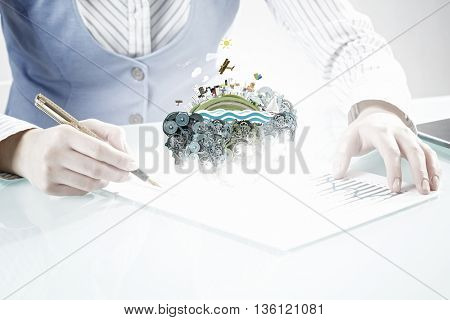 Businesswoman working at desk . Mixed media