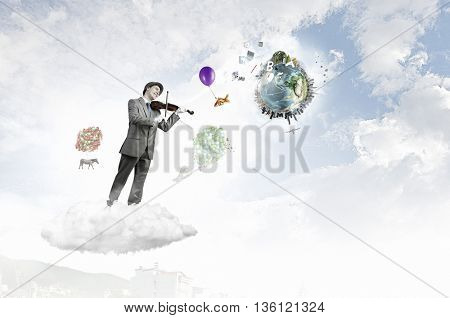Man playing holiday melody . Mixed media