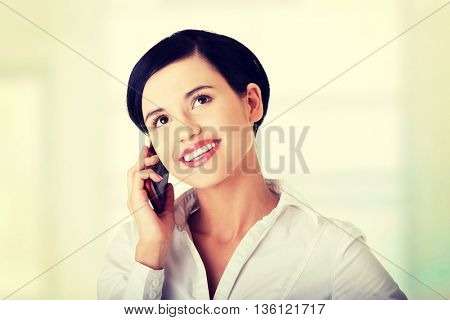 Attractive businesswoman with mobile phone.