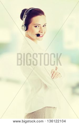 Beautiful woman on call center with microphone and headphones.