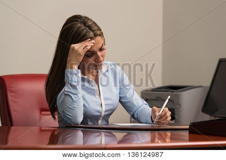 Young Business Woman With Problems In The Office