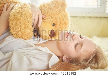 sensual girl dreaming with teddy bear toned image