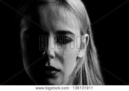 sad girl crying on black background monochrome