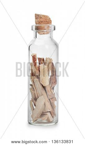 Dried calamus in glass bottle on white background