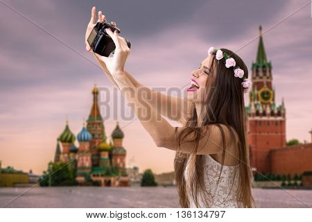 Young brunette girl taking selfie photo in Moscow, Russia