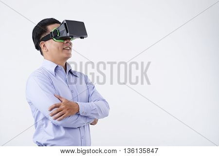 Portrait of confident businessman in virtual reality headset