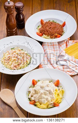 Italian kitchen pasta spaghetti carbonara bolognese on  wooden background served in a restaurant