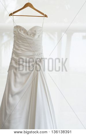 White wedding dress for the bride was hanging waiting
