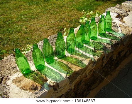 10 Green Bottles sitting on a wall depicting a UK nursery rhyme.