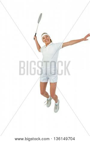 Badminton player playing badminton on white background