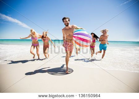 Friends having fun at the beach on a sunny day