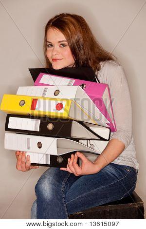 Woman Holding Ring Binders