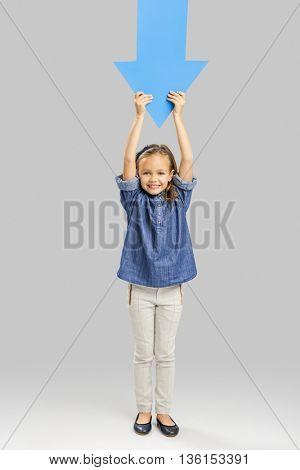 Girl holding a big blue arrow