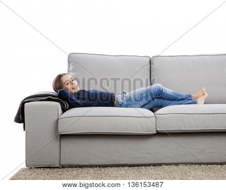 Little girl lying on a couch and resting