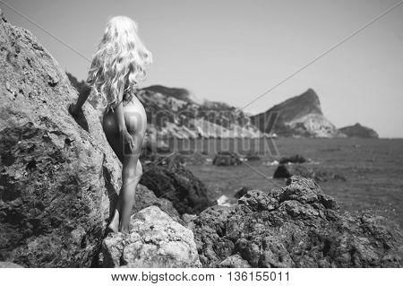 Portrait of beautiful  nude blonde on the nudist beach