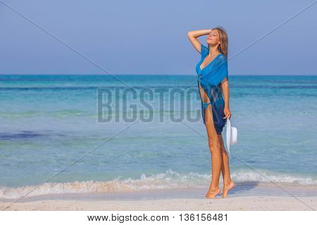 woman on beach summer holiday slim and beautiful in Mallorca, Spain