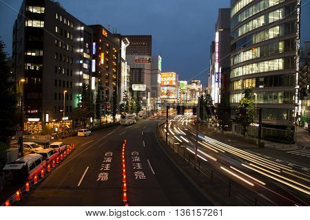TOKYO-JAPAN, 27 June 2016:  Shinjuku street during magic hour with light trails in Tokyo, Japan