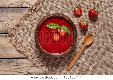 Strawberry soup healthy vegetarian fresh summer berry fruit smoothie dessert food, vitamin rich nutrition meal on vintage wooden background
