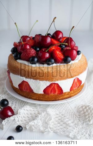 Strawberry cake homemade gourmet sweet dessert bakery food decorated with berries and whipped cream on white background table