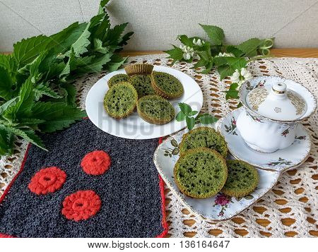 Nettles green cookies on plate, cooking food from weed using wild plants