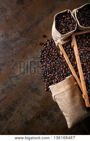 Jute Bags And Wooden Containers Filled With Cofee Beans