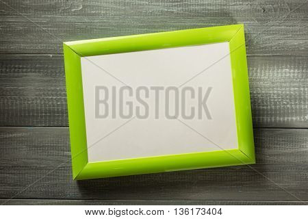 photo picture frame at wooden background