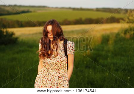 Woman With Backpack In The Nature. Young Beautiful Woman Portrai