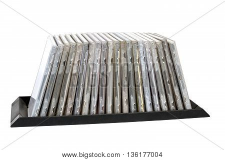 Stacked Old Grungy Compact Disk Holders On White