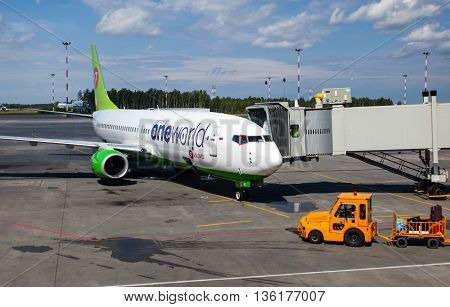 RUSSIA, SAINT-PETERSBURG, INTERNATIONAL AIRPORT PULKOVO - 17 JUNE 2016: Airplane Boeing 737-800 of S7 Airlines, member of One world alliance is ready for boarding passengers