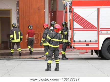 Team Of Firefighters In The Firehouse