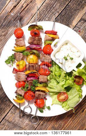 beef skewer and salad