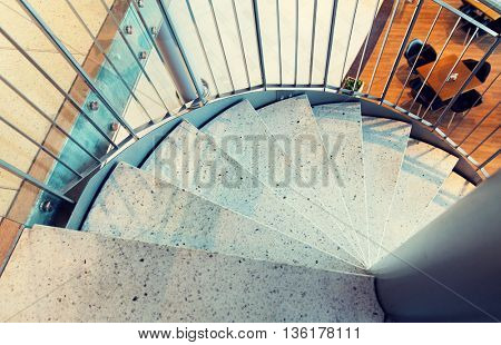 architecture, design and interior concept - close up of stone spiral staircase at restaurant