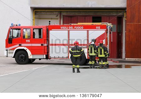 Vehicle Carrying Firefighters And Equipment For Fighting Fire