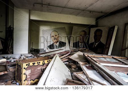 Pripyat, Ukraine - May 29, 2016: abandoned school room with pictures and debris on the floor in Pripyat, Chernobyl, Ukraine