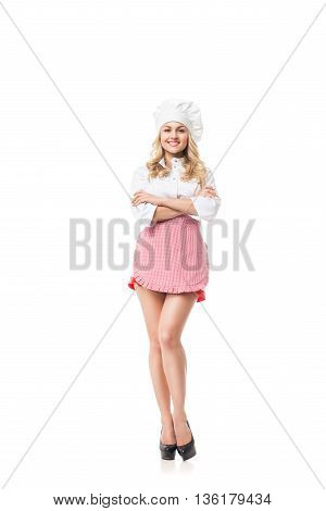 Portrait of attractive blonde woman in hat and apron.Isolated