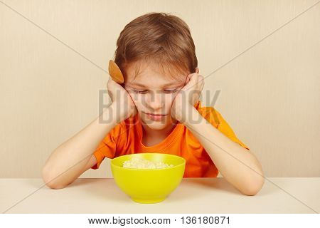Little boy does not want to eat a cereal